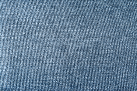 Old and worn blue jeans pattern background in a king size  photo