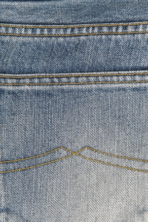Detail of the classic seams in old blue jeans photo