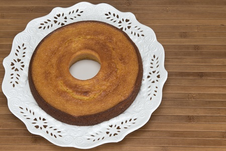A plate with a homemade cake on a wooden surface. Stock Photo - 17193640