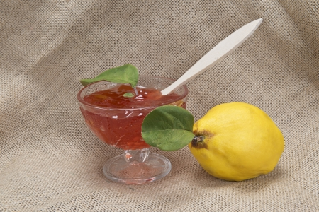 quinces: Still life with quinces and quince jelly in a glass cup