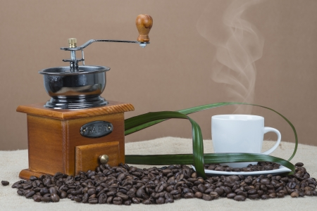 Still life about coffee with cups, beans and a mill 写真素材