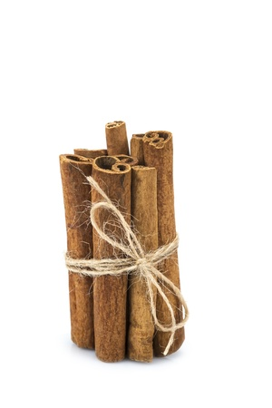 Cinnamon sticks isolated over a white background photo