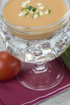 andalusian cuisine: Andalusian gazpacho in a glass bowl chilled with ice cubes