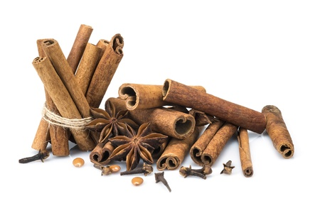 Cinnamon sticks and star anise isolated over a white background photo