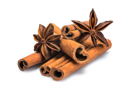 Cinnamon sticks and star anise isolated over a white background
