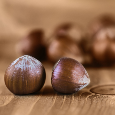 Some hazelnuts on an old wooden background Stock Photo - 22366665