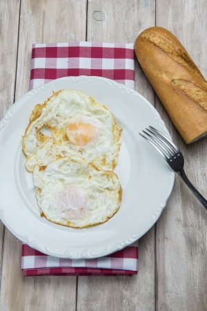 sunny side up: A dish of fried eggs with bread