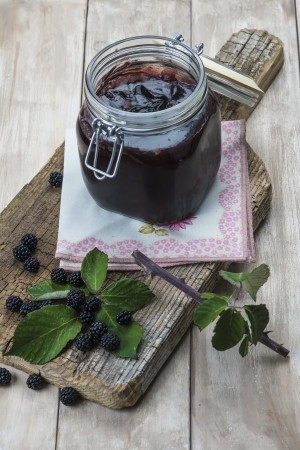 brambleberry: A pot with blackberry jam and some fresh fruits and leaves