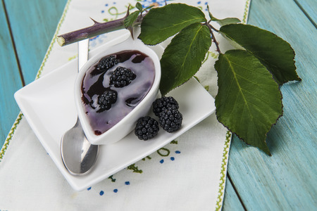brambleberry: A little bowl with blackberry jam and some fresh fruits and leaves