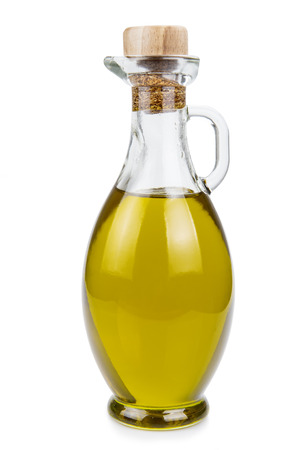 olive  oil: Olive oil in a glass bottle and green olives isolated over a white background