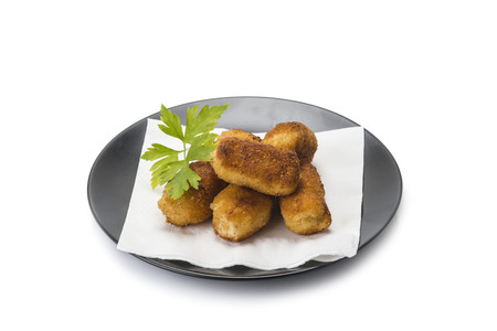 croquettes: A plate with homemade croquettes decorated with parsley