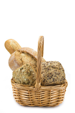 hamper: Still life about a basket with a large bread assortment isolated over a white background