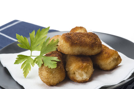cod oil: A plate with homemade croquettes decorated with parsley