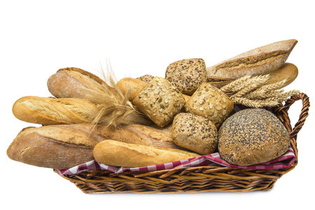 Still life about a basket with a large bread assortment isolated over a white