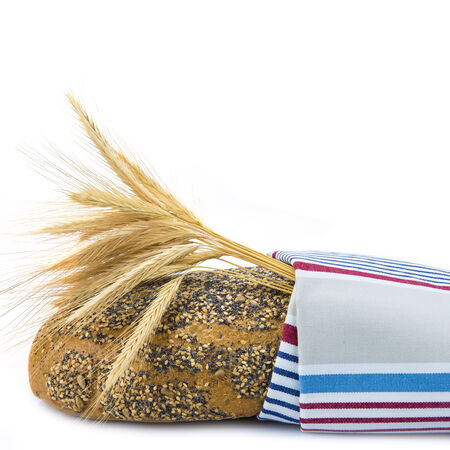 dishcloth: Bread covered with a dishcloth isolated on a white