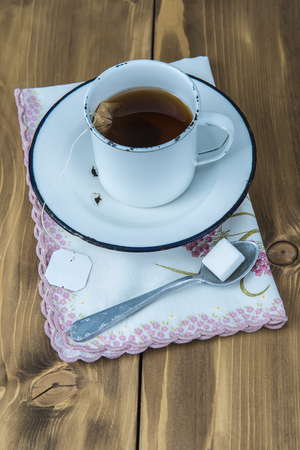 infuser: A cup of tea on a wooden Stock Photo