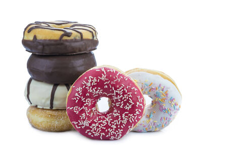 Donuts assortment in different colors isolated on a white  photo