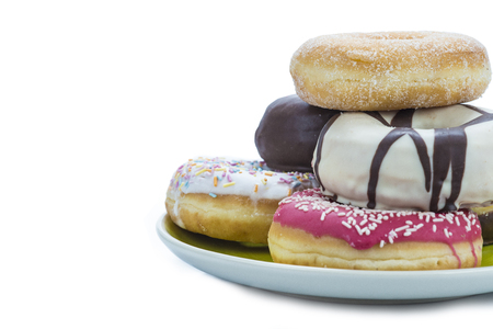 Donuts assortment in different colors isolated on a white background photo