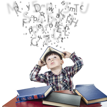 Child againts the rain of numbers and letters with a book over his head Banque d'images