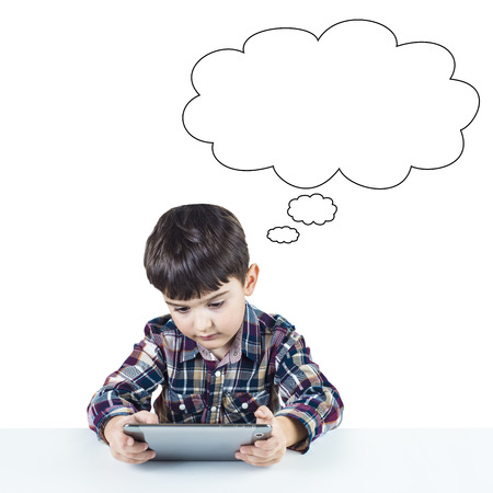 A child playing games with a digital tablet photo