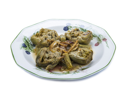 heathy diet: Artichokes cooked with onion for a heathy vegetarian diet Stock Photo