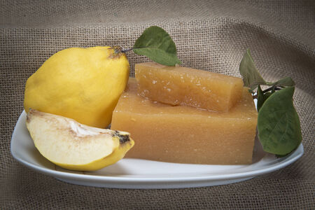 apple core: Still life with quinces and homemade quince cheese Stock Photo