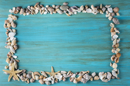 Summer holidays in blue with fishing net ans seashells and a space for advertising