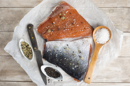 pink salmon: Smoked marinated salmon and ingredients on the kitchen table