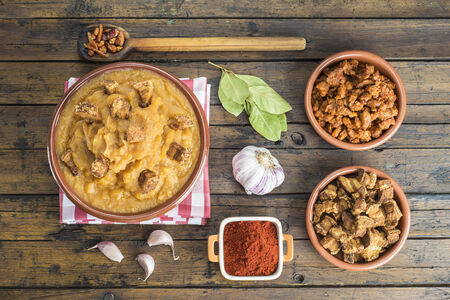 Traditional Spanish double-mashed potatoes or bobbed potatoes with smoked paprika Stock Photo