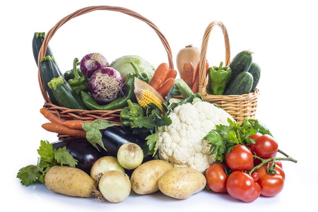 escarole: A basket with assortment of vegetables isolated on a white background