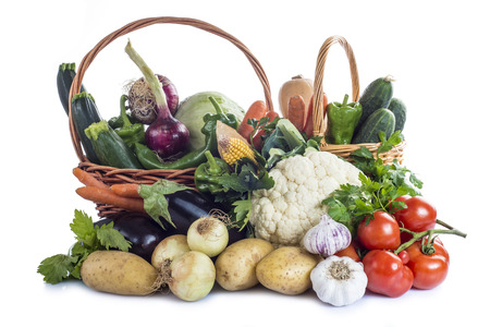 A basket with assortment of vegetables isolated on a white background photo