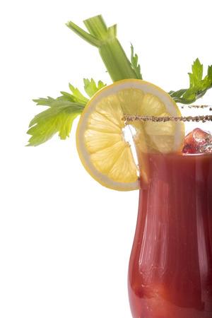 porn: Кровавый Мэри коктейль украшенный с сельдереем и лимоном на белом фоне Фото со стока