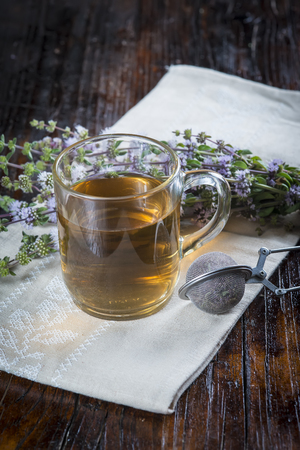 wild mint: Mentha pulegium infusion on a wooden table