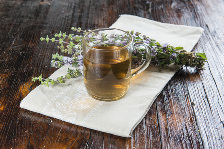 teas: Mentha pulegium infusion on a wooden table
