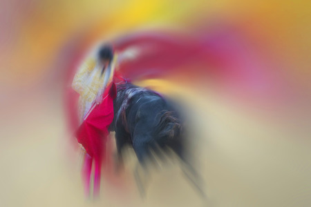 Colorful abstract drawing about bullfight with a bullfighter fighting with a bull photo