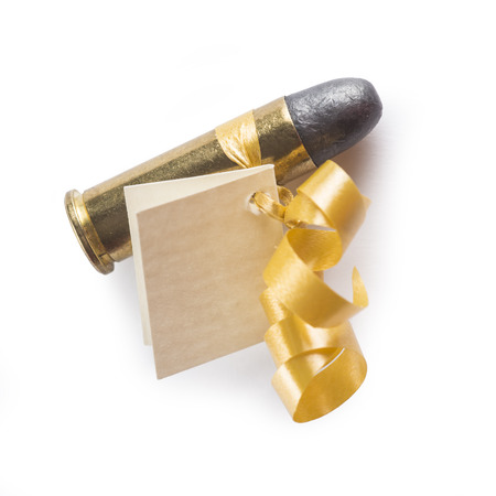 38 caliber: Bullet with a greeting card decorated like a gift and meaning threat isolated on a white background