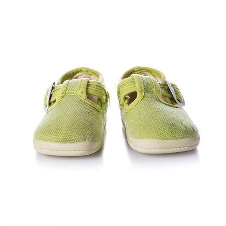 informal clothes: Green sneakers shoes with buckles for kids isolated on a white background Stock Photo