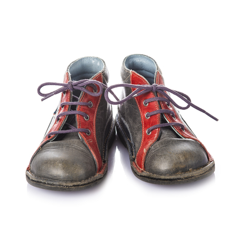 lacing: Leather boots for kids in red and grey isolated on a white background Stock Photo
