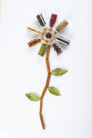 Flower made of spices and herbs isolated on a white background photo