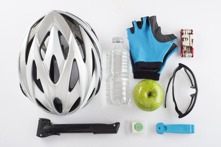 safety gloves: Items for a safe cycling and a healthy diet isolated on a white background Stock Photo