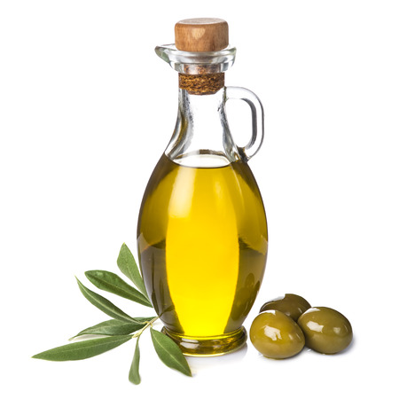 Extra olive oil bottle and green olives with leaves isolated on a white background Archivio Fotografico