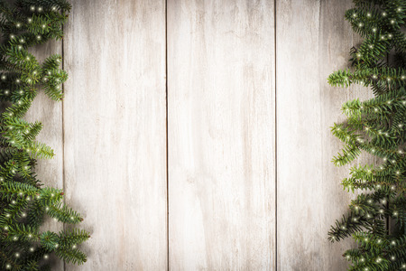Christmas card background with a space for text on a wooden surface and decorated with fir branches Stockfoto