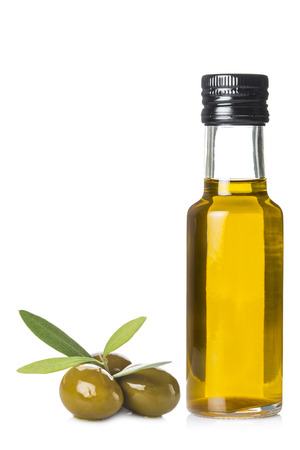 olive green: Extra olive oil bottle and green olives with leaves isolated on a white background Stock Photo