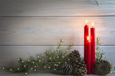 Christmas wooden background with candles and a space for text