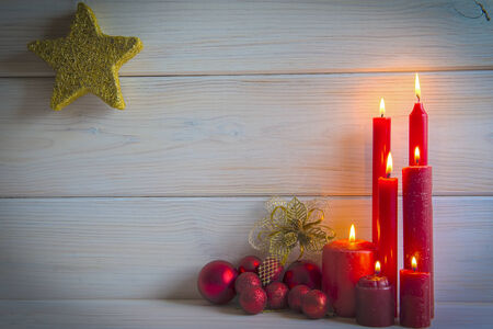new year tree: Christmas wooden background with candles and a space for text