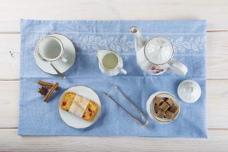 fruitcake: Table set for brakfast with candied fruit cake, tea and coffee