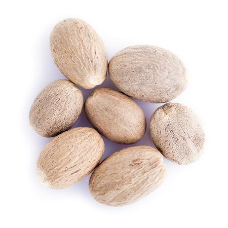 nutmeg: Nutmeg seeds isolated on a white background