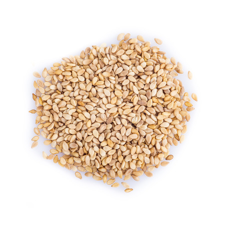 Roasted sesame seeds isolated on a white background