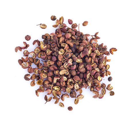 Dried Sichuan pepper isolated on a white background Stock Photo