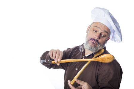 playing with spoon: Funny cook man isolated on white background fiddling with two wooden spoon Stock Photo